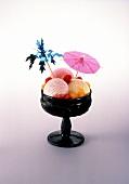 Ice cream sundae: 3 scoops ice cream, raspberries, mandarins
