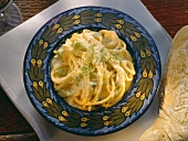 Spaghetti with 3 kinds of cheese, cream sauce & spring onions