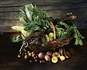 Several cabbages, turnips & leafy vegetables in basket, nuts