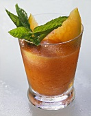 Papaya & pineapple drink, garnished with papaya slices & mint