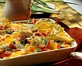 Vegetable gratin with potatoes, fennel, carrots, spring onions