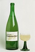 Federweisser (young wine) from Franken in glass and bottle