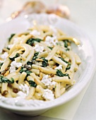 Pasta with spinach & ricotta sauce with raisins & pine nuts