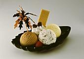 Three scoops of ice cream (mocha, stracciatella, banana)