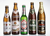 Five different German beers in bottles (with labels)