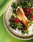 Smoked salmon trout on rocket and beetroot salad