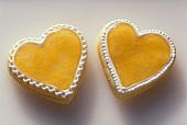 Two Heart Shaped Orange Filled Cookies