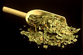 Dried eucalyptus leaves on wooden scoop