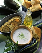 Tzaziki, fried aubergine slices, flat bread & olive oil