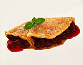 Pancake with cherry compote