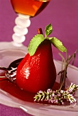 Pear poached in rose wine