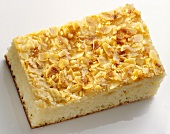 A piece of butter cake with almonds