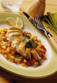 Fried chicken breast fillet on mango & pepper salsa