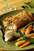 Baked cod fillets with breadcrumb crust and vegetable