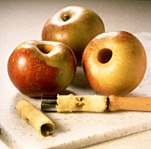 Preparing baked apples: coring the apples