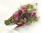 Flowering herb bouquet in willow basket