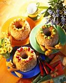 Praline fruit cake with coloured sugar eggs & marzipan bunnies