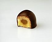 A Chocolate Bonbon with a Bite Taken Out