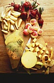 Swedes, turnips, parsnips and beetroot on wooden board