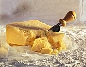 Wedge of Pamesan Cheese; Pieces Broken Off