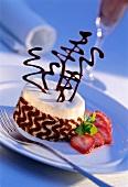 Black and white sponge cake with layer of vanilla cream