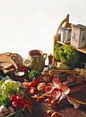 Rural snack ingredients: vegetables, bread, fat, ham, wine