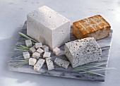 Tofu, herb and smoked tofu on marble platter