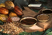 Still life with cacao fruits, cocoa beans and end products