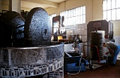 Olivenmühle & dahinter Olivenpresse in italienischer Fabrik