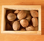 A Wooden Box Full of Walnuts