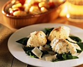 Spinach & quark dumplings on spinach with Parmesan curls