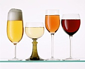A glass each of beer, white wine,  rose wine and red wine