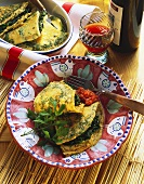Frittata with spinach on plate and in bowl