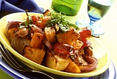 Baked autumn vegetables (potatoes, onions, carrots, pumpkin)