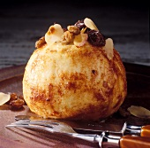Baked apple with raisin and almond filling