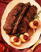 Saddle of venison & apples with cranberries on oval platter