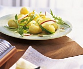 Marinated potatoes with apple wedges,Parmesan & rocket