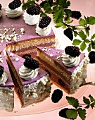 Blackberry cream gateau, pieces cut, one piece on cake server
