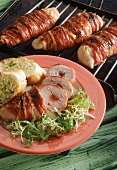 Grilled chicken rolls with redcurrant jelly, wrapped in bacon