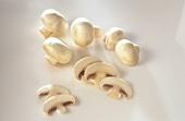 Five button mushrooms and mushroom slices