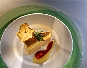 A piece of savoury goose liver cake on plate