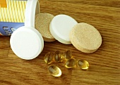 Various vitamin & mineral tablets on wooden background