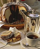 Marble cake with marzipan, pieces cut and cup of coffee