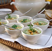 Peas soup with salmon strips & croutons in bowl