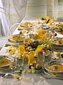 Easter table with carrot soup in plates, Easter wreath