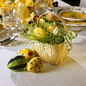 Easter basket: chip basket with Easter eggs on table