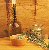 Dried rosemary, sprig of fresh rosemary and rosemary oil