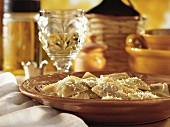 Filled pasta parcels sprinkled with parmesan, in deep plate
