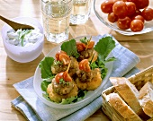 Rosti & mince snacks with tomatoes & bowl of dip