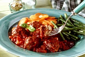 Meatballs (lamb) in tomato & red wine sauce with vegetables